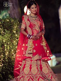 Indian bride wearing bridal lehenga and jewelry.#IndianBridalFashion