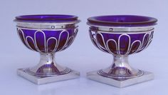 French 1st Standard 950 sterling silver open salts with cobalt glass liners by Ambroise Mignerot, Paris, c.1810 - 1820.  These exquisite salts have wire frame bodies and heavy rims and square bases.  Each is marked with the old Association of Gold and Silversmiths mark and the maker's mark on the rims and under the bases. The cobalt glass liners fit well and appear to be original.