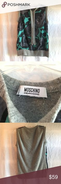"""Moschino Cheap&Chic Sleeveless Top Has a Hook and Eye Clasp at front with 2 knit drapes. Material: Knit: 54% Rayon, 30% Virgin Wool, 14% Polyester, 2% Other. Front: 100% Silk Chiffon. Care: Professionally Dry Clean Only. In Gently Used Condition. Great Deal!! 😁😁 Length 19"""", Pit to Pit 12"""" Moschino Tops Tank Tops"""