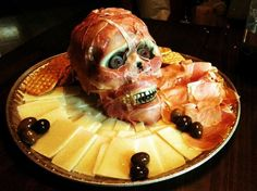 Halloween Food Hacks: Easy Spooktacular Hors d'Oeuvres « Food Hacks  You can't just serve up a platter of cold cuts at a Halloween party. You definitely have to go the extra mile and serve a creepy skinned head version (especially when it's really not hard to assemble).