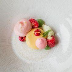 Raspberries with champagne mousse, verbena, lime, herbs and meringue. Top class dessert by chef Koen Somers at restaurant De Kristalijn in Genk.