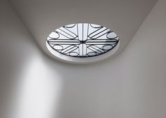 A decorative metal screen adorns a skylight
