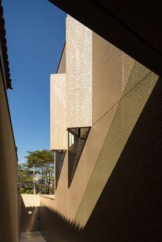 K House / Studio Arthur Casas, metal, perforated, pattern, copper, brass