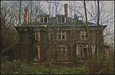 The Abandoned Manor House in the Woods on a Hill, South Wales. Hidden away in an area of woodland, this once great house has slipped into a state of ruin, helped on its way by vandals and arsonists. 12.14.2011