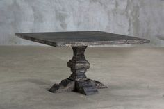 "54"" Square Pedestal-leg reclaimed elm table made with timbers salvaged from dismantled industrial buildings. Each piece is handmade by a single carpenter using traditional methods."