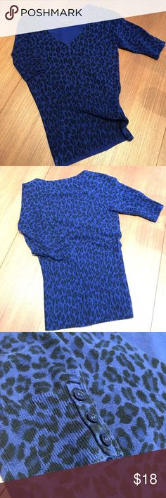 Express purple leopard/cheetah print sweater Shirt sleeve sweater. Sleeves have three button accent. Blueish-purple with black print. EUC! Express Sweaters