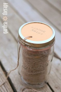 How to Make a Mason Jar Garden Twine Dispenser and many other mason jar crafts Mason Jar Twine, Mason Jars, Pot Mason, Bottles And Jars, Mason Jar Crafts, Canning Jars, Mason Jar Garden, Craft Storage, Yarn Storage