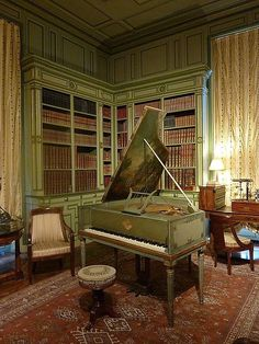 Here is an old square grand you can find in the Castle of Giverny, France library.  #piano #room
