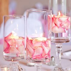 DIY wedding centerpieces with rose petals and candles. DIY wedding decor on a budget. Ideas and inspiration for wedding gifts, favours, venue decoration and keepsakes . Make Your Own and DIY projects would be great choices Summer Wedding Centerpieces, Elegant Centerpieces, Centerpiece Ideas, Christmas Centerpieces, Quinceanera Centerpieces, Wedding Vases, Food Centerpieces Wedding, Diy Wedding Table Decorations, Cheap Table Centerpieces