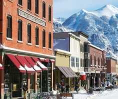 AMERICA'S FAVORITE TOWNS 2013 <> Telluride, Colorado <> Deep within a glacier-carved valley, this mining camp–turned–vacation destination is perhaps best known for its pristine Rocky Mountain scenery and steep, challenging ski terrain. It's also a cultural hub, rating it No. 1 in the music category for annual events like the Telluride Bluegrass and Blues & Brews festivals. Those seeking a holiday winter wonderland should note that the town also snagged the No. 1 spot for Christmas lights.