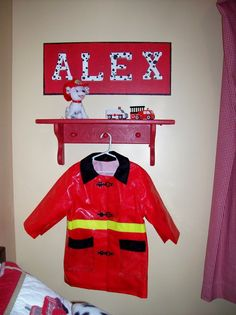 """Fire Truck Room, Final Repost, Thanks for all the suggestions. My son insisted that I paint the shelf red and he even helped. I added the mural this afternoon and I am calling this space complete. I finally got the """"Its perfect!"""" from my son. , Boys Rooms Design"""
