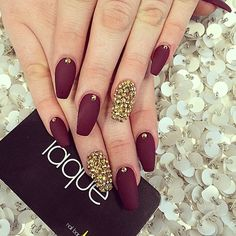 burgundy nails with the gold bejeweled accent nail