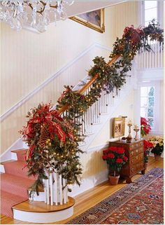 Elegant Banister Decorated with Garland and Pinecones for Christmas