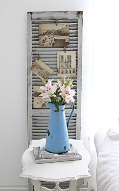 old shuttered turned photo display #pegs #photos #vintage #grey