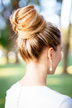 A big high bun with cute earrings - perfect!
