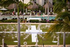 Chandeliers, mixed chairs, and more make this modern wedding shine here in the Central Garden at Dreams Playa Mujeres Golf & Spa Resort! #DestinaitonWedding #GardenWedding #Chandelier #GhostChair