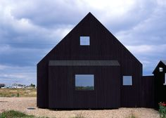 Black-stained Dungeness beach house replaces an old fisherman's cottage