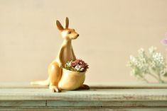 There are many charming ways to display a plant other than using a conventional clay pot. Japanese shop Harimogura has crafted playful solutions to this design challenge with nature-themed planters that hold succulents and small blooms. Adorable aardvarks, kangaroos, cats, and crocodiles are sculpted with personalities that evoke the feelings you'd have with an old friend. To produce these tiny sculptures, Harimogura uses a cast resin and realistically paints them using lacquer pigment…
