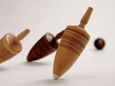 """This """"Thunderbolt"""" spinning top is the most difficult top Klaus makes. Often referred to as """"Grandpa's top"""", is it suitable for all ages and a real challenge. The sense of accomplishment you get when this top is spinning upright is truly satisfying. The top is made from a single piece of wood, complete with a metal spike and oil finished. Woods used to make these tops:Fruit Trees. Klaus rates this top a 6 out of 6 in terms of difficulty"""