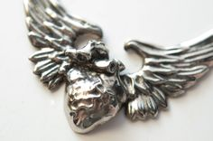 Anatomical Human Heart Wing necklace by Bakutis. $45.00, via Etsy.