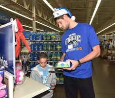 On Dec. 9, Orlando Magic players Nikola Vucevic (photo 1), Victor Oladipo (photo 2) and Elfrid Payton (photos 3 & 4) spread holiday cheer taking youth from the Boys & Girls Clubs of Central Florida shopping as part of the Magic and PepsiCo.'s annual holiday shopping spree.  Each youth received $100 gift cards to shop, compliments of PepsiCo. Photos taken by Fernando Medina.