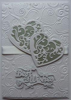 Wedding card with spellbinders die & embossing folder & tattered lace sentiment die. Made by Lynne Lee.