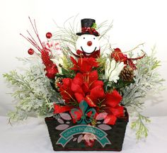 Beautiful Christmas Table Centerpiece With Snowman by Crazyboutdeco on Etsy Christmas Projects, Christmas Wreaths, Christmas Table Centerpieces, Silk Flower Arrangements, Floral Supplies, Party Entertainment, Beautiful Christmas, Silk Flowers, Wedding Favors