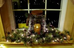 Swag or garland on the kitchen window... with light in the middle!  Cute idea..