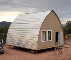 Chelsea & Brian bit the bullet and build a tiny arched cabin. These might be one of the most cost effective and fast to build cabin kits out there. Learn more about these cabin kits at the Arch… Tiny House Cabin, Tiny House Living, Tiny House Design, Cabin Homes, Tiny Homes, Glamping, Quonset Hut Homes, Arched Cabin, Cabin Kits