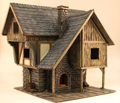 It`s quite liberating to finally show the finished houses because it means new and completely different terrain projects for me. Hence let`s continue on to the Smiths house. If you missed the Merch… Figurine Warhammer, Medieval Houses, Gnome House, Fantasy House, Stone Houses, Miniature Houses, Fairy Houses, Small World, Model Homes