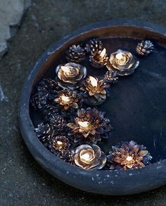 beautiful tea lights floating in bird bath, sweet for a porch at night