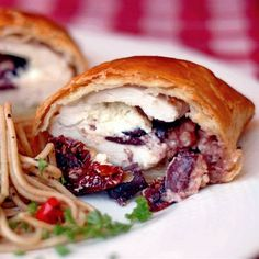 Mediterranean Chicken Wellington Recipe Main Dishes with frozen pastry puff sheets, boneless chicken breast, feta cheese, sun-dried tomatoes, fresh oregano, pitted kalamata olives, salt, pepper, eggs, cold water