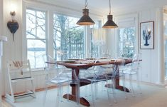When the outdoors become the focus of the indoors, as they do in this lakeside dining room, the clear seating only enhances the view. Ghost Chairs Dining, Dining Room Table Decor, Dining Room Design, Dining Room Furniture, Dining Area, Kitchen Decor, Kitchen Ideas, Lakeside Dining, Decoration