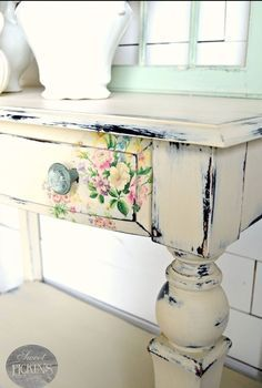 Beautiful distressed farmhouse table with floral detail.