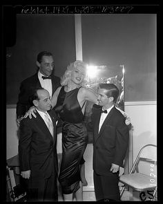 Jayne Mansfield with jockeys Johnny Longden, Eddie Arcaro and Willie Shoemaker at Jockeys' Ball in Los Angeles, Calif., 1957. Los Angeles Times photographic archive, UCLA Library
