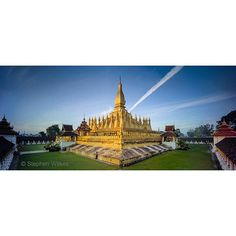 """Photo by @stephenwilkes: From the #NatGeo August feature story on Laos written by TD Allman """"Painted gold That Luanga 16th-century stupa in Vientianeis believed to hold relics of the Buddha. In 1991 it became part of the national emblem of Laos replacing the communist hammer and sickle. I encourage all to read the story (link in my profile) and learn about the strength of the Lao people through decades of tragedy and war and the beautiful country that they call home.  #Laos #stupa…"""