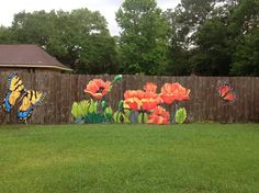 What a great way to brighten up your fence ... now you dont need to plant any flowers!  By Lori Anselmo Gomez on Facebook ~ in Pearl River, Louisiana.