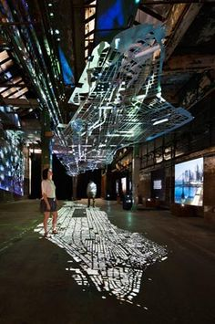 A floating replica of Manhattan's road infrastructure scale), an installation made of aluminum by Columbia University architecture students for the Experiments in Motion Exhibition at the Essex Street Warehouse, New York City. Photos by Collin Erickson. University Architecture, Architecture Student, Light Art Installation, Installation Architecture, Architecture Panel, Drawing Architecture, Architecture Portfolio, Modern Architecture, Exhibition Display