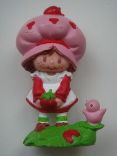 Strawberry Shortcake miniature. Where is my collection now? My ex-husband lost it.
