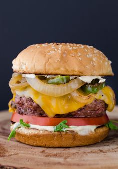 The Ultimate Juicy Burger is a mouth watering, cheese oozing, and grease dribbling extravaganza. This recipe will teach you how to make the perfect burger. Fire up those grills for Labor Day and let's chomp on some delicious ground chuck. I'm not messing Juicy Burger Recipe, Beef Burgers, Veggie Burgers, Toast Sandwich, Good Food, Yummy Food, Delicious Burgers, Grilling, Food Porn