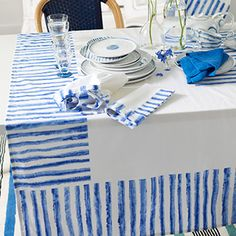 A Cobalt twist using water colour on crisp cotton makes DG dining accessories something special
