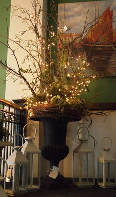 Arrangement of real and faux branches with white lights.