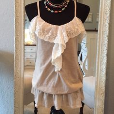 Lace ruffled spaghetti top NWOT, never worn. Beige racerback spaghetti top with lace ruffle trim, elastic waist and adjustable straps. Also available in Heather Blue. Edge by Mine Tops