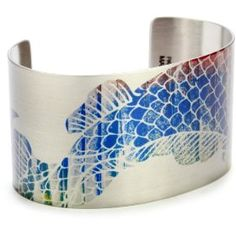 Tattoed Steel bracelet -- as you can see the designs are also in color, not just black onto steel.  Love the colors!