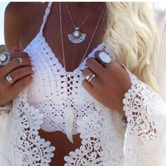 White knit boho crochet crop top Brand new never worn. Ties like a halter behind your neck and again behind your back (like a swimsuit) slightly padded . Very cute. Perfect for summer. Fits a b-c cup Tops Crop Tops