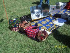 Faustine Odaba's solar cookers that she produces and uses in Kenya.   Sacramento, CA SCI Festival, 19 July 2014