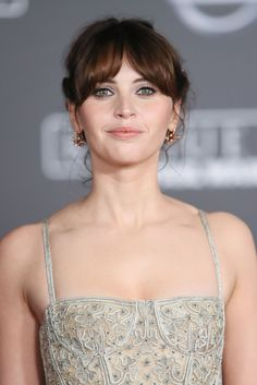 Felicity Jones - I really like this haircut. ROund face, part in the middle, extensions to the side/