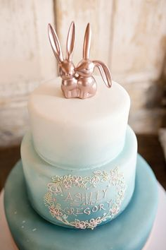Whimsical wedding cake with rose gold bunny cake topper | Photo by The Cannons Photography | Whimsical Rose Gold Wedding on heartlovealways.com