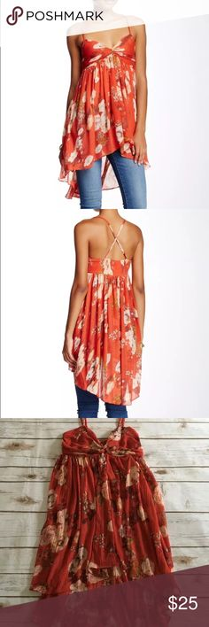 Free People Mirage Tunic tank red size XS NWT This flowy floral top from Free People features adjustable straps, a ruched knot at the bust, and a high-low hem. You can remove the straps and wear as a tube top! Lightly ribbed fabric.   100% Polyester Free People Dresses High Low
