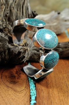 """Sterling Silver Bracelet with Turquoise from the Lander Blue Mine, designed by Federico Jimenez. 2 1/8"""" diameter and 1 1/4"""" width."""